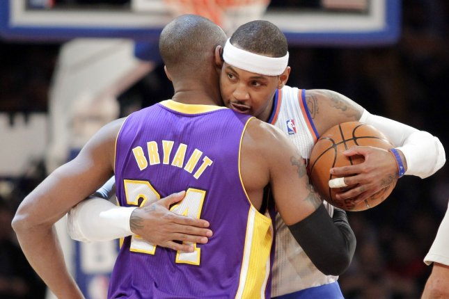 Former New York Knicks star Carmelo Anthony (R) and Los Angeles Lakers legend Kobe Bryant meet on the court before a game on Dec. 13, 2012, at Madison Square Garden in New York City. File Photo by John Angelillo/UPI
