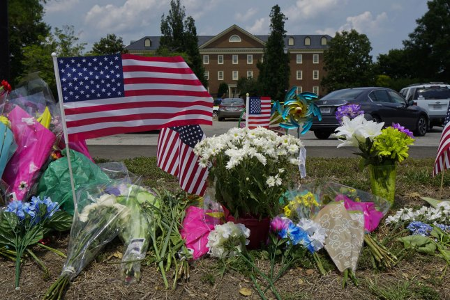 Flowers and flags surround a makeshift memorial on June 2, 2019, outside the government building where a disgruntled employee killed 12 people on May 31, 2019, in Virginia Beach, Va. File Photo by Ray Stubblebine/UPI