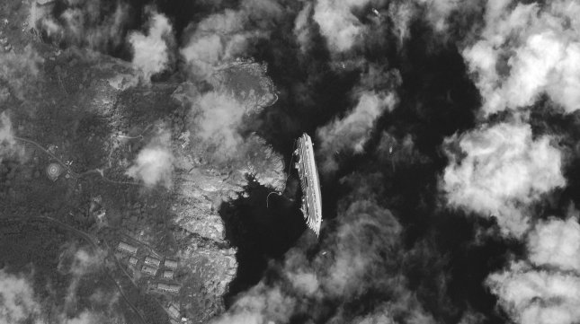 A satellite image captured by Digital Globe of the Costa Concordia, a luxury cruise ship that ran aground in the Tuscan waters off of Giglio, Italy on Friday, January 13, 2012. UPI/Digital Globe/HO