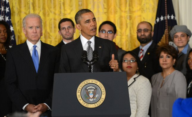President Barack Obama makes a point on immigration reform in the East Room of the White House in Washington, DC on October 24, 2013. The president called on congress to pass an immigration reform bill by the end of the year that would provide a path to citizenship for 11 million immigrants living in the United States illegally, and also tighten border security. At left is Vice President Joe Biden. UPI/Pat Benic