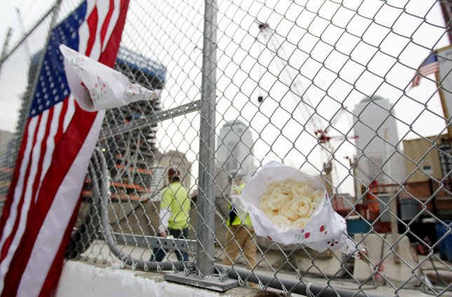 Flowers and flags are placed on the fence surrounding Ground Zero, the site of the former Twin Towers, hours after Osama Bin Laden is killed by U.S. Navy Seals almost 10 years after the terrorist attacks on the World Trade Center at Ground Zero in New York on May 2, 2011. UPI/John Angelillo