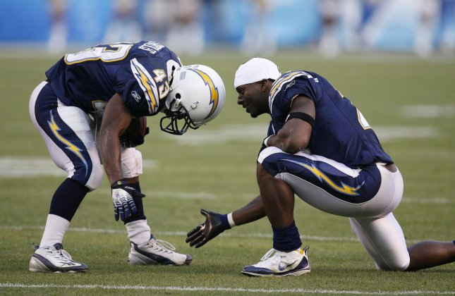 San Diego Chargers running back LaDainian Tomlinson (right) congratulates running back Darren Sproles after he scored a touchdown in the fourth quarter against the Detroit Lions at Qualcomm Stadium in San Diego on December 16, 2007. (UPI Photo/Robert Benson)