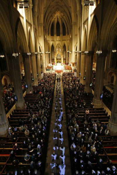 Harris Poll finds U.S. belief in God down from previous years. A procession of priests files into St. Patrick Cathedral at the Solemn Vespers ceremony for for New Archbishop of New York Timothy Dolan in New York on April 14, 2009. (UPI Photo/Mike Segar/Pool)