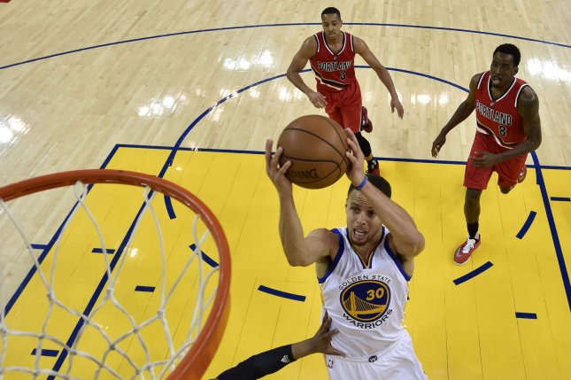 Golden State Warriors guard Stephen Curry (C) goes to the basket for two points against the Portland Trail Blazers during their NBA Western Conference playoffs game. File photo by John G. Mabanglo/UPI