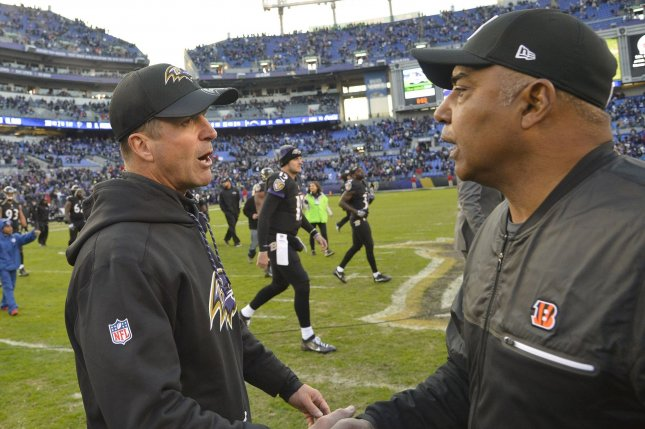 Baltimore Ravens head coach John Harbaugh (L) greets Cincinnati Bengals head coach Marvin Lewis (R) after Baltimore's 19-14 win at M&T Bank Stadium in Baltimore, Maryland, November 27, 2016. File photo by David Tulis/UPI