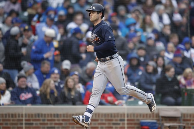Atlanta Braves right fielder Preston Tucker rounds the bases after hitting three-run home run off Chicago Cubs starting pitcher Yu Darvish in the fifth inning of a baseball game on April 13 at Wrigley Field in Chicago, Ill. Photo by Kamil Krzaczynski/UPI