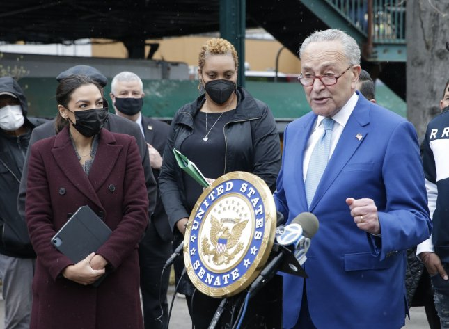 Sen. Charles Schumer, D-N.Y., and Rep. Alexandria Ocasio-Cortez announcethe launch of the Federal Emergency Management Administration hotline on Monday to help pay for the funeral and burial of COVID-hit families in New York City. Photo by John Angelillo/UPI