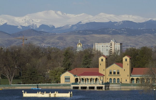 The Colorado State Capitol golden dome stands dwarfed by the Rocky Mountains Mount Evans in Denver on April 30, 2011. UPI/Gary C. Caskey