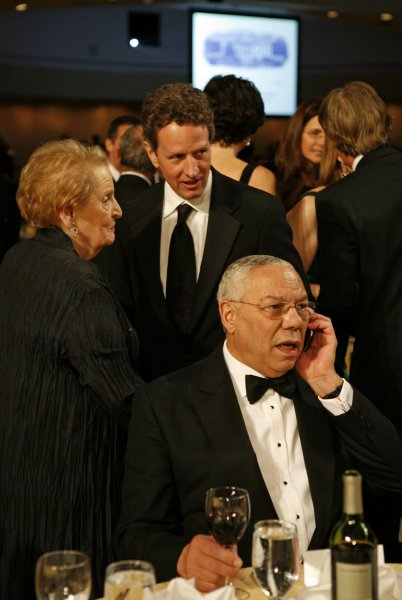 Treasury Secretary Timothy Geithner (C) chats with former Secretary of State Madeleine Albright as former Secretary of State Colin Powell talks on his cell phone prior at the annual White House Correspondents' Association gala dinner at the Washington Hilton Hotel in Washington on May 9, 2009. (UPI Photo/Martin H. Simon/Pool)