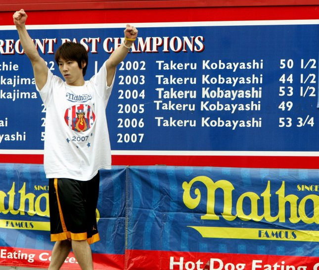 Six-time champion Takeru Kobayashi of Japan waves to the crowds as he is inttroduced beffore the start of theNathan's Famous hot dog contest held in Coney Island on July 4, 2007 in New York City. (UPI Photo/Monika Graff)