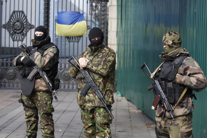 Ukrainian self-defense volunteers stand outside the parliament building in Kiev on March 17, 2014 a after the referendum on independence in Crimea. UPI/Ivan Vakolenko