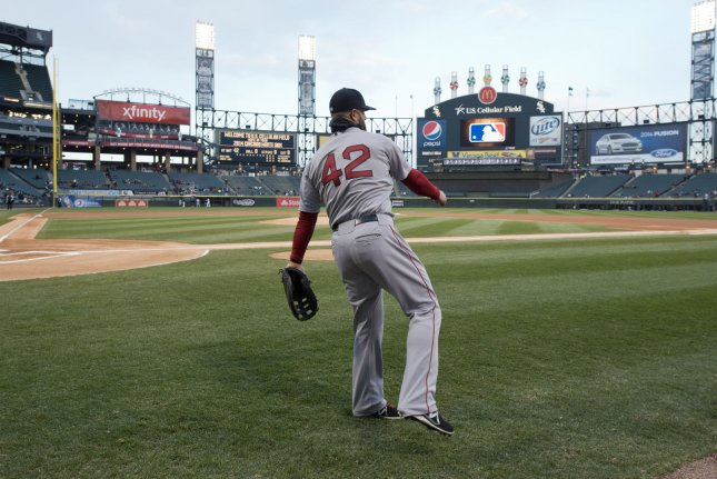 Boston Red Sox first baseman Mike Napoli warms up before the game against the Chicago White Sox at U.S. Cellular Field on April 15, 2014 in Chicago. All players wore number 42 in honor of Jackie Robinson. UPI/Brian Kersey