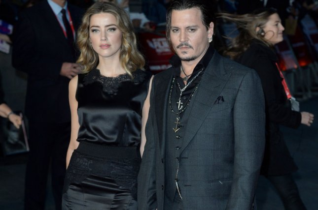 Amber Heard and husband Johnny Depp at the BFI London Film Festival screening of 'Black Mass' on Oct. 11. The actress addressed split rumors in the December issue of Marie Claire. File Photo by Paul Treadway/UPI