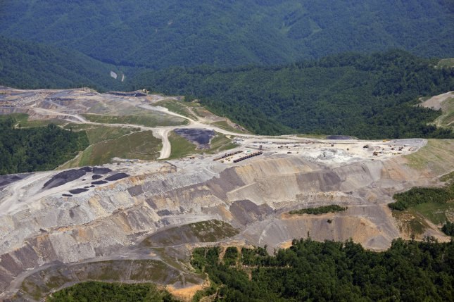 An aerial photo shows a mountaintop removal site and sludge pond in southern West Virginia, where mountaintops are blasted off to expose multiple seams of coal on May 26, 2013. The Obama administration issued new regulations to protect streams and groundwater from coal mining. File photo by Debbie Hill/UPI