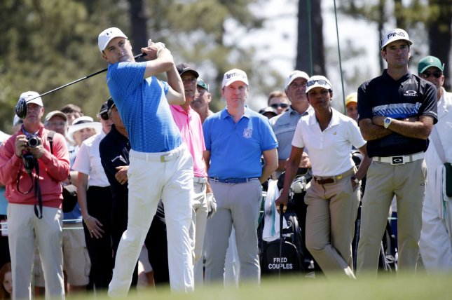 983714ae239ed5 ... Condoleezza Rice and Bubba Watson watch Jordan Spieth hit a tee shot  while playing a practice round at the 2017 Masters Tournament at Augusta  National ...