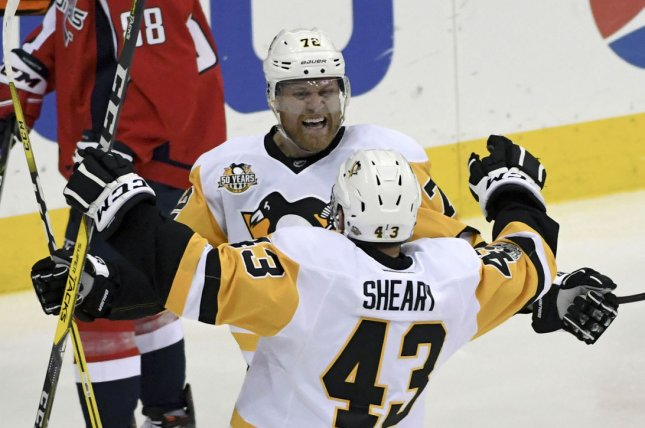 Pittsburgh Penguins right wing Patric Hornqvist (72) is congratulated by left wing Conor Sheary (43) after his goal in the third period against the Washington Capitals at the Verizon Center in Washington, D.C. on May 10, 2017, in game seven of the second round of the Stanley Cup Playoffs. File photo by Mark Goldman/UPI