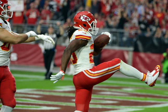 Former Kansas City Chiefs running back Jamaal Charles does a high step as he enters the end zone for his second touchdown of the game in the second quarter of the Chiefs-Arizona Cardinals game at the University of Phoenix Stadium in Glendale, Arizona. File photo by Art Foxall/UPI