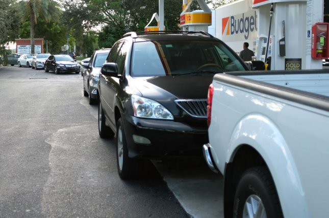 Vehicles are seen at a Shell gas station in Boynton Beach, Fla. The continued popularity of sport-utility vehicles and trucks, experts say, are partly fueling the climate crisis. File Photo by Gary I Rothstein/UPI