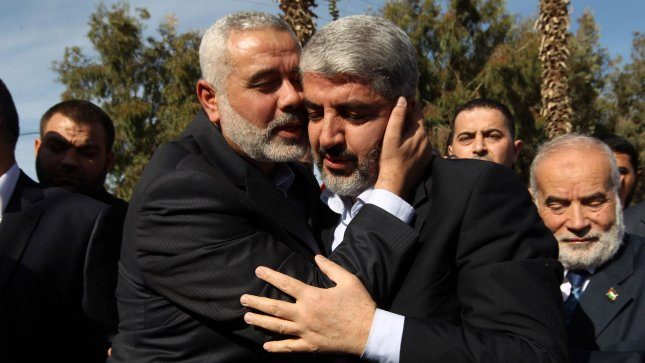 Hamas leader-in-exile Khaled Meshaal (R) and Hamas leader in the Gaza Strip Ismail Haniya (L) embrace following Meshaal's arrival in Rafah, southern Gaza, on December 7, 2012. Meshaal is making his first-ever visit to the Gaza Strip amid tight security for festivities marking the ruling Islamist movement's 25th anniversary. UPI/Mohamed Al Ostaz/Palestinian PM Media