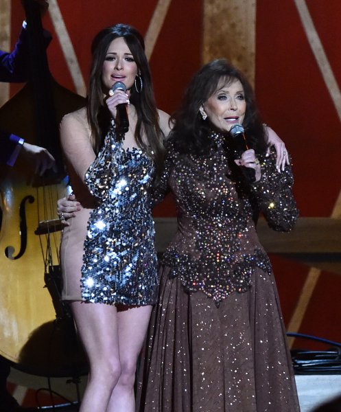 Kacey Musgraves performs a duet with country great Loretta Lynn (R) during the 48th Annual Country Music Awards at Bridgestone Arena in Nashville on November 5, 2014. UPI/Kevin Dietsch