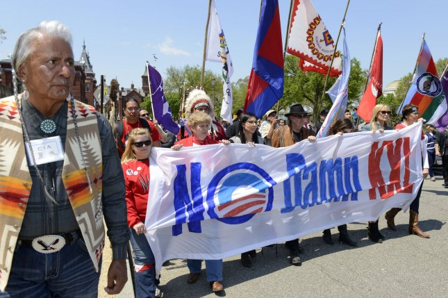 Rock star Neil Young (C,wearing hat) and actress and activist Daryl Hannah (2nd,R) marched against the Keystone XL pipeline on join marchers during a demonstration organized by the Cowboy Indian Coalition on April 26, 2014, in Washington. UPI File Photo/Mike Theiler