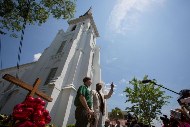Pastors Dimas Salaberrios (right) and Kyle Kneen speak to mourners during a vigil outside Emanuel African Methodist Episcopal Church on Saturday, June 20, 2015 in Charleston, South Carolina. The vigil was held for the nine people shot and killed inside the church on June 17, 2015. A suspect, Dylann Roof, 21, was arrested in connection with the shootings. Photo by Kevin Liles/UPI