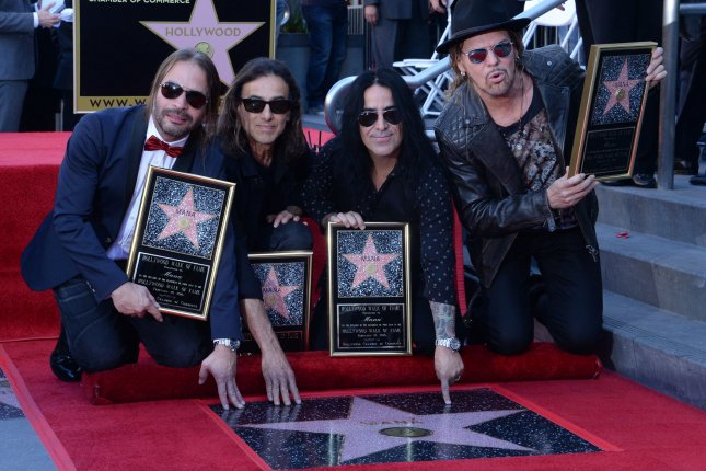 Alex Gonzalez, Sergio Vallin, Juan Calleros and Fher Olvera (L-R), members of the Mexican rock band Maná, hold replica plaques during an unveiling ceremony honoring the group with the 2,573rd star on the Hollywood Walk of Fame in Los Angeles on February 10, 2016. Photo by Jim Ruymen/UPI