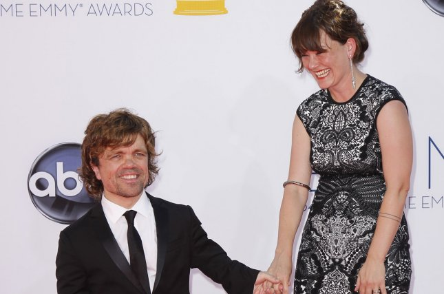 Peter Dinklage and wife Erica Schmidt arrive at the 64th Primetime Emmy Awards on September 23, 2012. Schmidt was seen placing her hand on top of a baby bump while attending the opening of her play All the Fine Boys. File Photo by Danny Moloshok/UPI