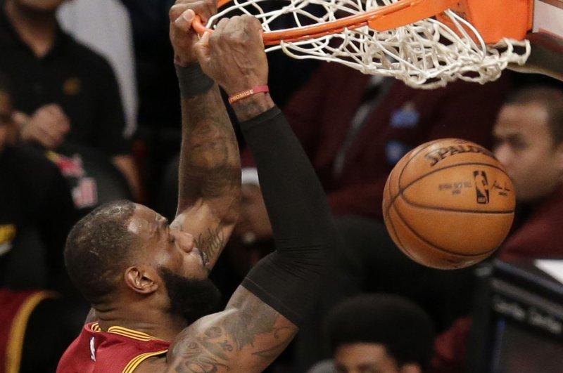 Cleveland Cavaliers LeBron James dunks the basketball. File photo by John Angelillo/UPI