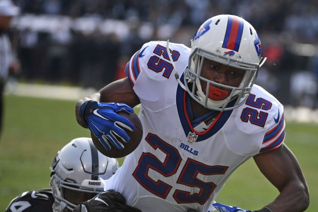 Buffalo Bills RB LeSean McCoy (25) is tackled by Oakland Raiders Perry Riley Jr. in the first quarter at the Oakland Coliseum in Oakland, California on December 4, 2016. File photo by Terry Schmitt/UPI