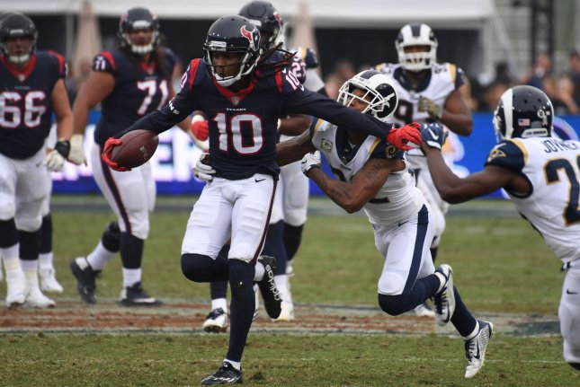 Houston Texans' receiver DeAndre Hopkins (10) eludes tackle of Los Angeles Rams cornerback Trumaine Johnson (22) on November 12 at the LA Coliseum in Los Angeles, Calif. Photo by Jon SooHoo/UPI