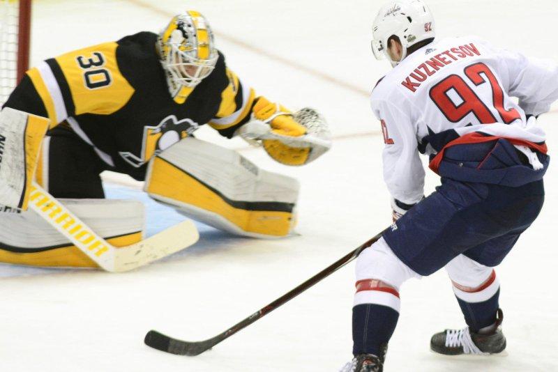 be36d7b7595 Washington Capitals center Evgeny Kuznetsov (92) scores a breakaway goal on  Pittsburgh Penguins goaltender Matt Murray (30) to win the game 2-1 in  overtime ...