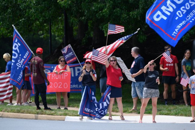 Activists show support for President Donald Trump on Saturday outside the Trump National Golf Club in Sterling, Va. Photo by Erin Scott/UPI
