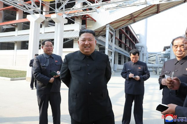 A South Korean analyst has said photos of Kim Jong Un issued after April 11 are fake. File Photo by KCNA/UPI