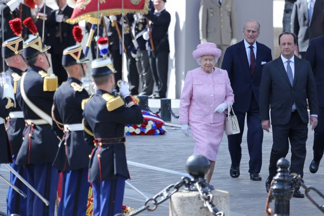 Prince Philip and Queen Elizabeth II are pictured at the Arc de Triomphe in Paris, France, on June 5, 2014. File Photo by David Silpa/UPI
