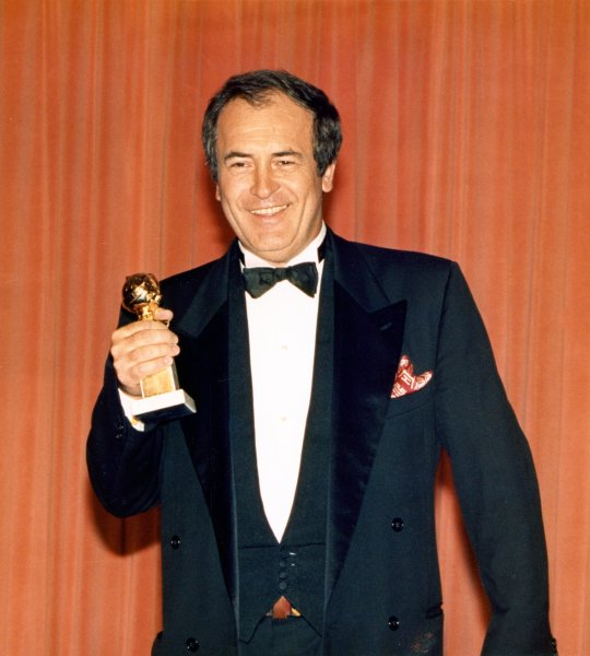 Italian director Bernardo Bertolucci holds his Golden Globe Award for best director of a movie on January 23, 1988 in Beverly Hills. He won for his film The Last Emperor. (UPI Photo/Glenn Wagnner/Files)