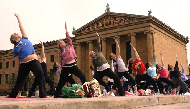 Some 600 breast cancer survivors and their families go through yoga exercises on the steps of the Philadelphia Art Museum in downtown Philadelphia May 20 2007. They participate in the the mass yoga class annually to raise funds and awareness of breast cancer issues. (UPI Photo/John Anderson)