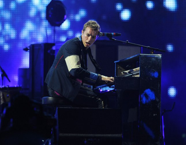 British singer Chris Martin performs with Coldplay at Wembley Stadium in London on September 18, 2009. UPI/Rune Hellestad