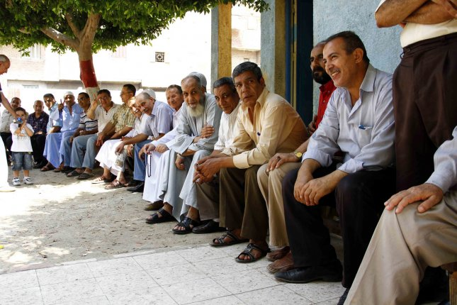 Egyptian men line up to cast their votes at a polling station in Cairo on June 16, 2012. Polling stations opened across Egypt for a presidential election run-off contested by Mohammed Morsi of the Muslim Brotherhood and Ahmed Shafik who was Hosni Mubarak's last prime minister. Some 50 million people are eligible to vote in the two-day poll to pick a successor to Mubarak, who was deposed in a popular revolt last year. UPI/Ahmed Jomaa
