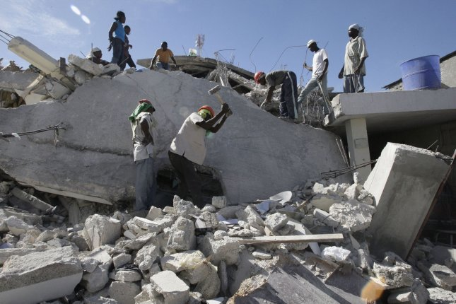 People look for victims of the earthquake on the remains of a house in Port-au-Prince, Haiti on January 16, 2010, after a 7.0 magnitude earthquake caused severe damage on January 12. UPI/Anatoli Zhdanov