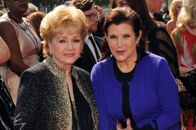 Debbie Reynolds and her daughter Carrie Fisher in a September 2011 UPI file photo.