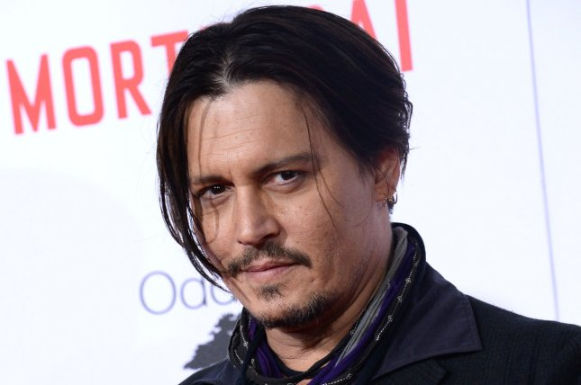 Cast member Johnny Depp attends the premiere of the motion picture comedy Mortdecai at the TCL Chinese Theatre in the Hollywood section of Los Angeles on January 21, 2015. Storyline: Juggling some angry Russians, the British MI5, his impossibly leggy wife and an international terrorist, debonair art dealer and part time rogue Charlie Mortdecai must traverse the globe armed only with his good looks and special charm in a race to recover a stolen painting rumored to contain the code to a lost bank account filled with Nazi gold. Photo by Jim Ruymen/UPI