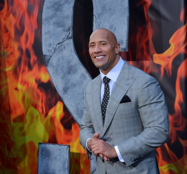 Dwayne Johnson attending the premiere of San Andreas on May 26. Johnson is featured in the first trailer for his upcoming action-comedy with Kevin Hart, Central Intelligence. File Photo by Jim Ruymen/UPI