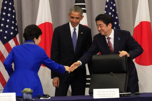 U.S. President Barack Obama attends a trilateral meeting with President Park Geun-hye of South Korea and Prime Minister Shinzo Abe of Japan at the Nuclear Security Summit in Washington, D.C., on Thursday. Pool Photo by Dennis Brack/UPI