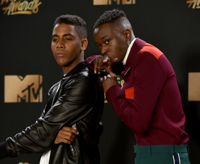 Actors Ashton Sanders (L) and Jharrel Jerome appear backstage with the Best Kiss award for their performance in Moonlight Sunday night at the MTV Movie & TV Awards at the Shrine Auditorium in Los Angeles. Photo by Christine Chew/UPI