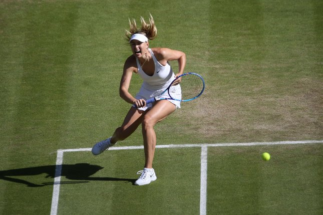 Russian Maria Sharapova returns the ball in the Women's Semi-Final match against American Serena Williams at the 2015 Wimbledon championships, London on July 9, 2015. File photo by Hugo Philpott/UPI