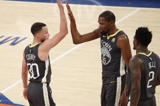 5a1dfccb5e61 Golden State Warriors guard Stephen Curry (30) and Kevin Durant (center) high  five after a time out is called in the third quarter against the New York  ...