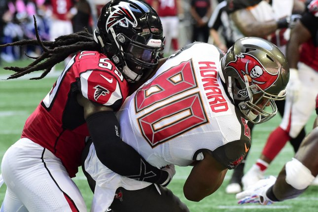 Tampa Bay Buccaneers tight end O.J. Howard (80) scores a 10-yard touchdown past Atlanta Falcons linebacker De'Vondre Campbell (59) during the first half on October 14, 2018 at Mercedes-Benz Stadium in Atlanta. Photo by David Tulis/UPI
