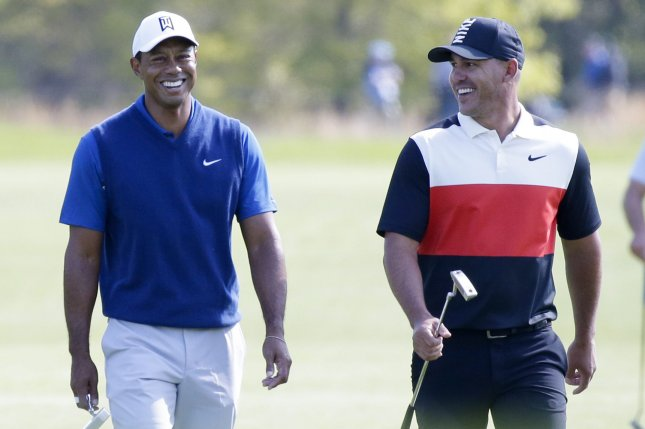 Tiger Woods (L) and Brooks Koepka are two of the betting favorites to win the 2019 U.S. Open. Koepka is a back-to-back champion at the major tournament. File Photo by John Angelillo/UPI