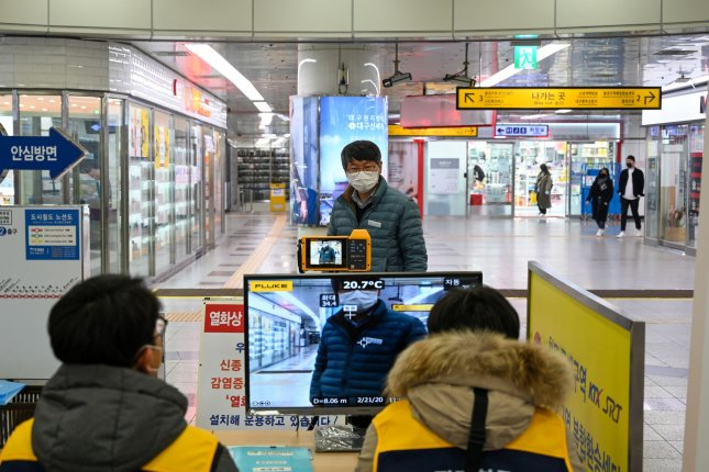 Transit workers use a thermal sensor to check a passenger's body temperature at a subway station in Daegu, South Korea on Feb. 21. South Korea has recorded over 4,000 confirmed cases of COVID-19. Photo by Thomas Maresca/UPI